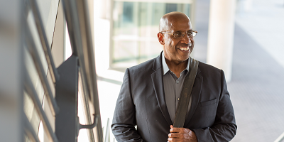 African American business man smiling as he walks