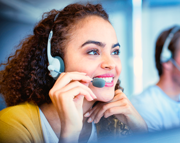Mixed race woman in call center on phone