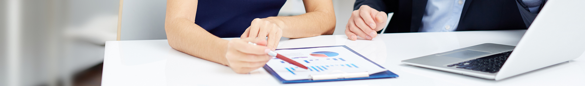 Professional woman and man review statistical figures together
