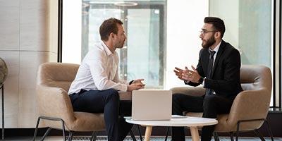 Two men having a conversation about commercial mortgage lending
