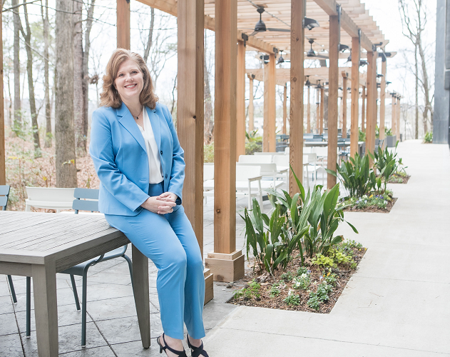 Female Protective employee standing in outdoor seating area