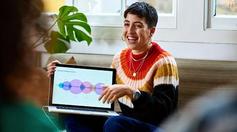 Smiling professional holding laptop