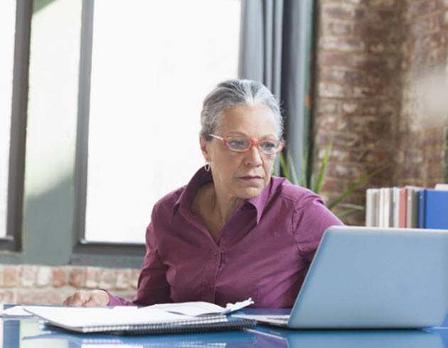 Older woman reading on computer