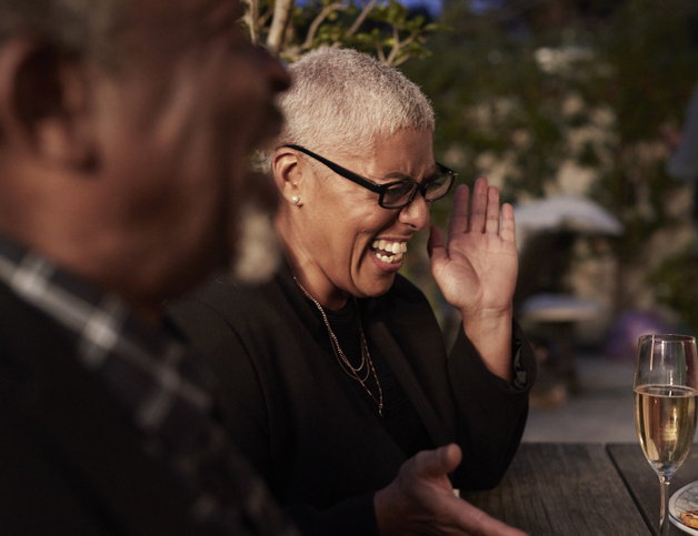 African-american woman laughing at retirement party