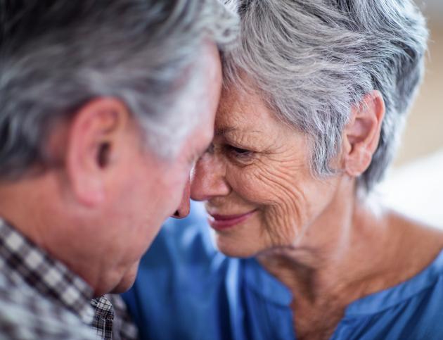 Senior couple touching foreheads