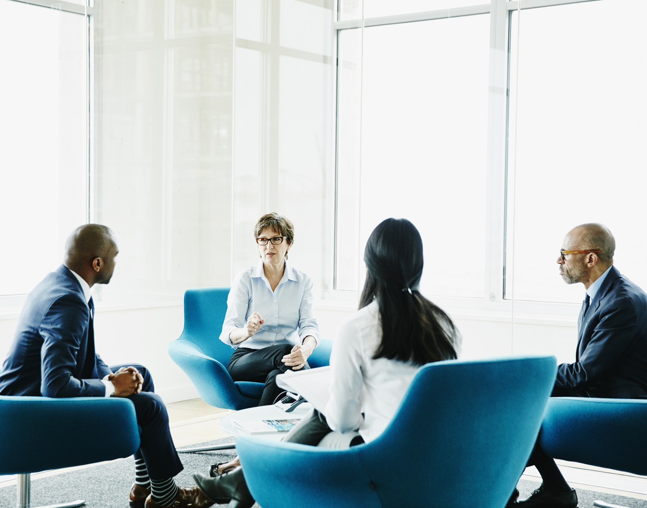 A group meets in an office.