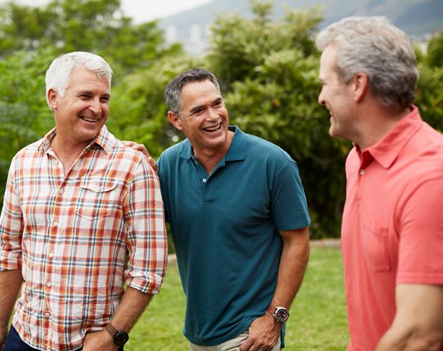Group of three smiling senior men