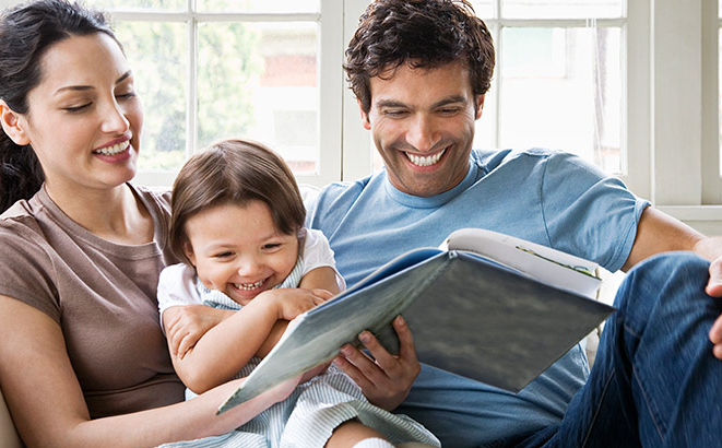 Young family reading together