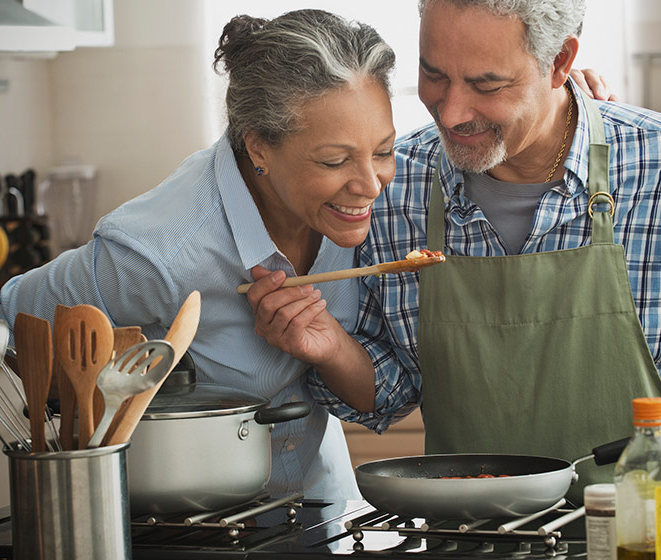 Middle-aged couple cooking together