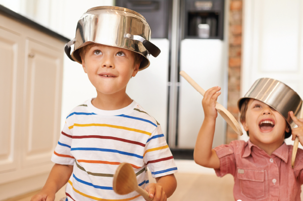 Picture of short term needs brochure kids playing in kitchen