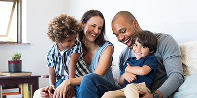 Young biracial family happy and thankful that they have adequate life insurance.