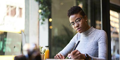 African-american woman doing research on life insurance myths