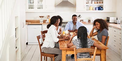African American family talks while enjoying breakfast together