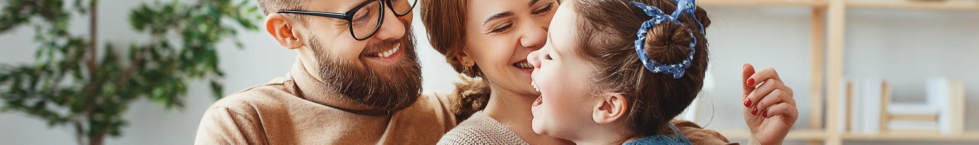 Father, mother and daughter laughing symbolizing a time of life when learning about life insurance is important.