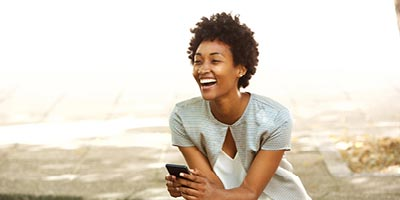 Young African-american woman laughing, symbolizing the perfect time answer life insurance questions