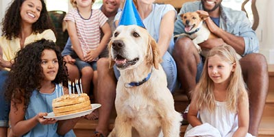 A family is gathered during a birthday party indicating a life change that may require a life insurance need.