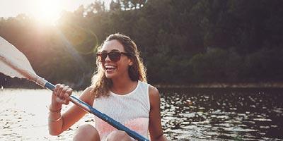 Single woman kayaking.