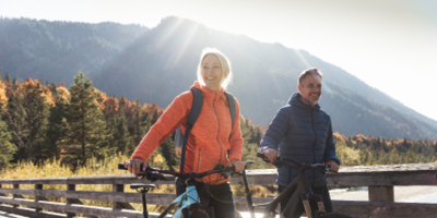 Young couple on bike ride in the mountains.