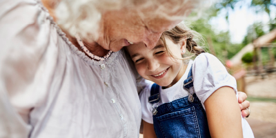 Grandmother and granddaughter share a warm embrace and a happy moment.