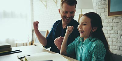 Father and daughter laughing, father wonders if he has made beneficiary mistakes on his life insurance policy