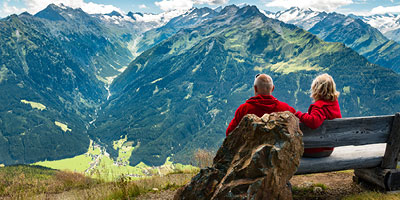 Older couple viewing mountain range, leveraging flexible life insurance benefits while still alive