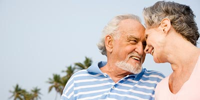 An older couple smiling at each other as they discuss getting remarried.