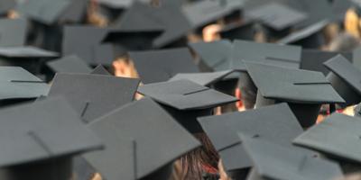 Overhead shot of a sea of graduation caps.