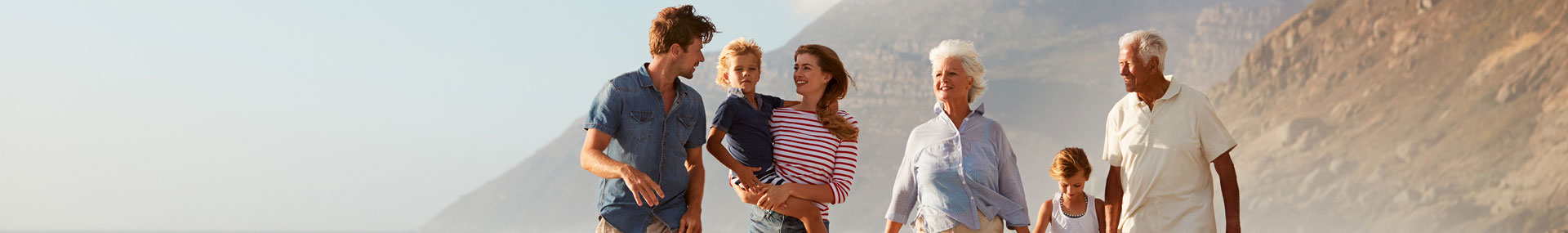 Multi-generational family walking outdoors.