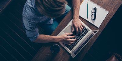 Man researching emergency loans online.