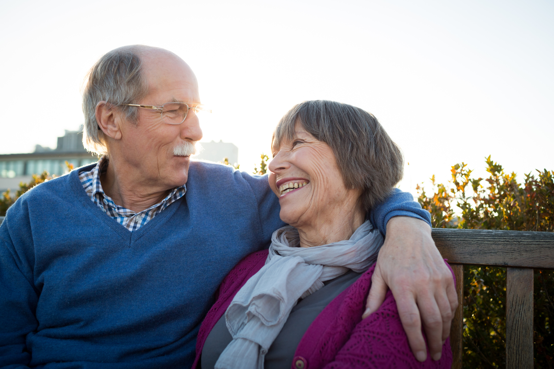 A senior adult couple smiling as they spend time together because they are secure in their future plans with a living will.