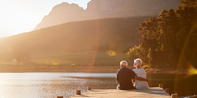 Senior couple enjoying a landscape view at sunset.