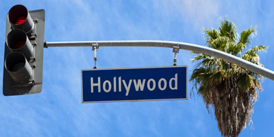Hollywood street sign hangs from traffic light