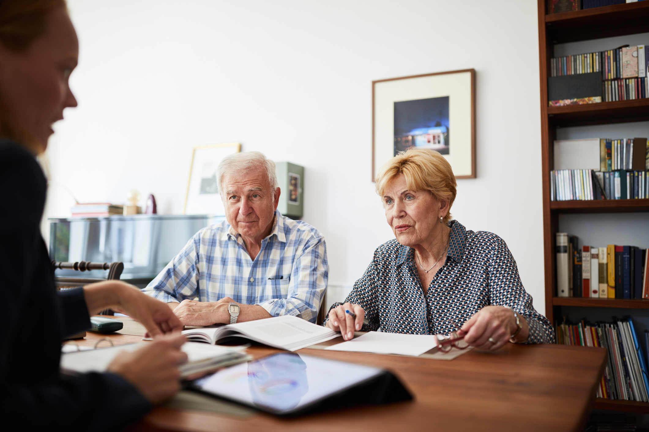 A senior adult couple speaking with an attorney to discuss power of attorney.