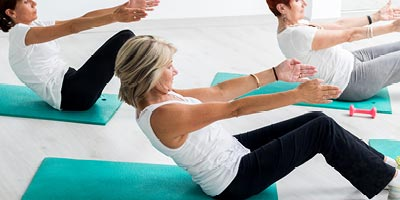 Woman of retirement age doing yoga to keep herself healthy.