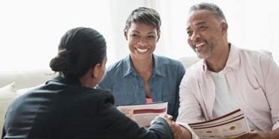 Smiling older couple meeting with a financial advisor
