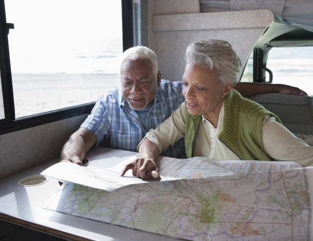 Older couple reviewing map from inside RV